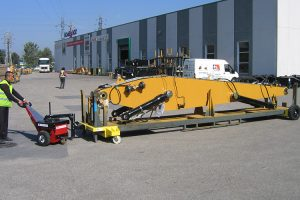 Power Pusher moving 3,500Kg excavator boom on mobile stillage