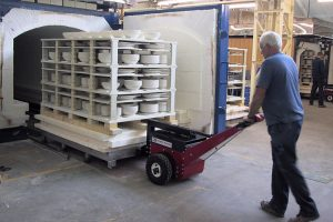 Power Pusher moving kiln trolley in and out of autoclave