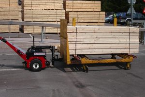 Power Pusher moving timber stacks at sawmill