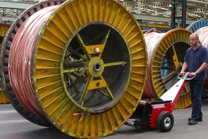 Power Pusher pushing cable drum at Prysmian